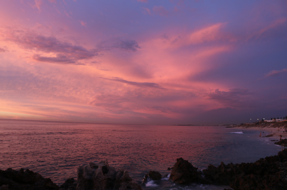 Purple and pink skies over the ocean after the sun has set