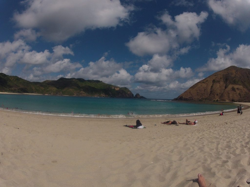 Beautiful beach shot in Southern Lombok, few clouds in the blue sky, sand and turquoise water
