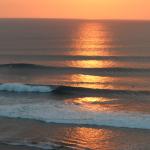 sunset over the surf in uluwatu