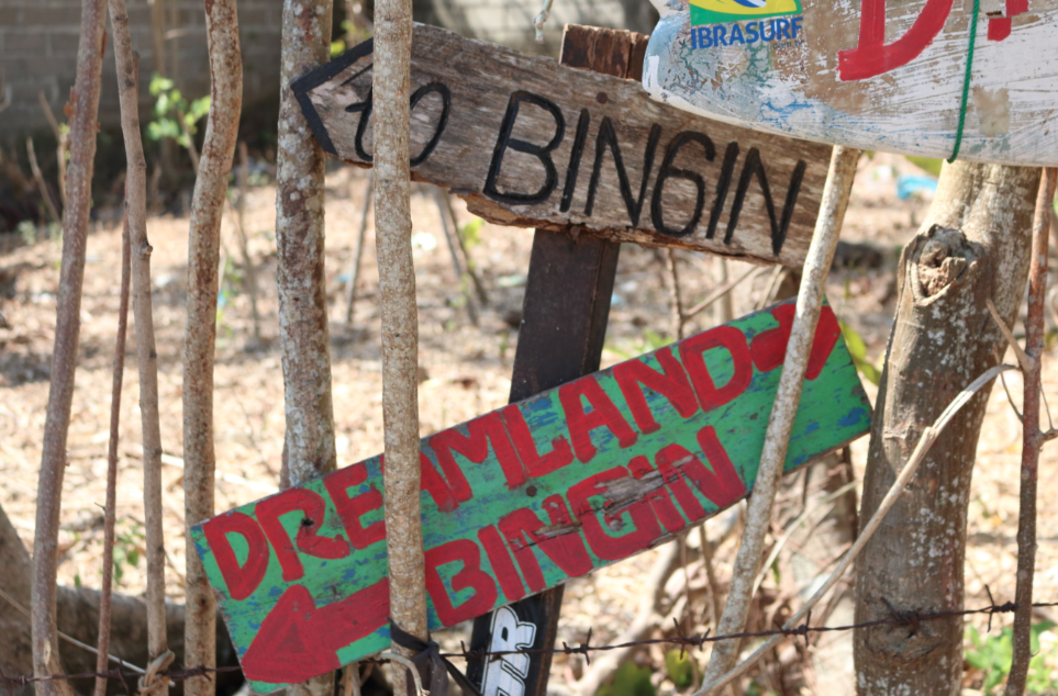 Signs to Bingin and Dreamland with arrows nestled amongst some spindly trees