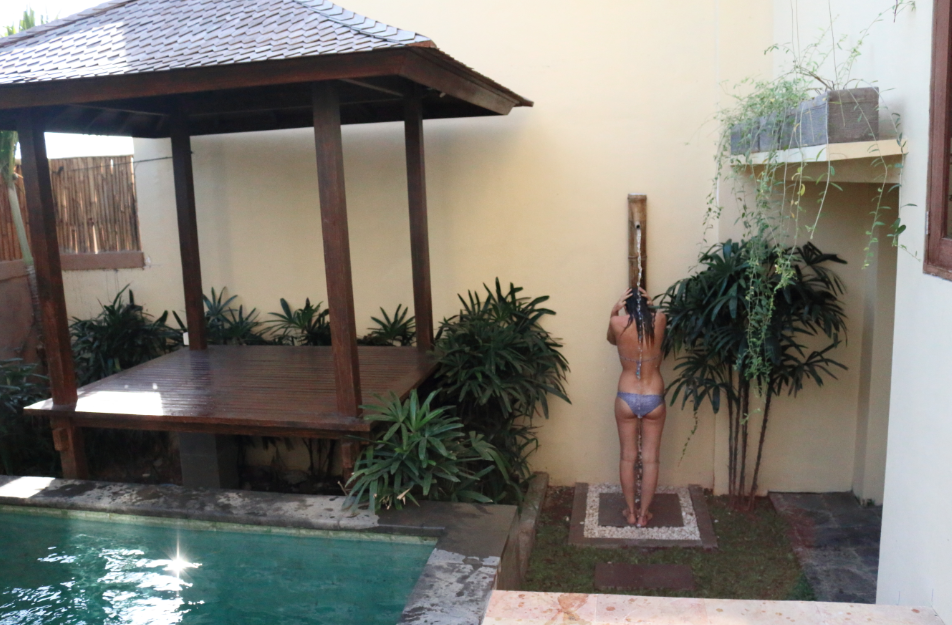 Tegan in the outdoor shower by the pool and bali hut