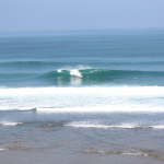 A nice wave rolling through Uluwatu