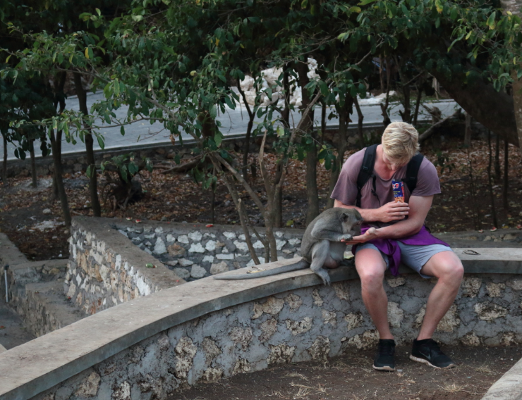 Dan getting close to a monkey, that stole his peanuts!