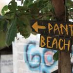 Beach sign under a tree in uluwatu, bali,