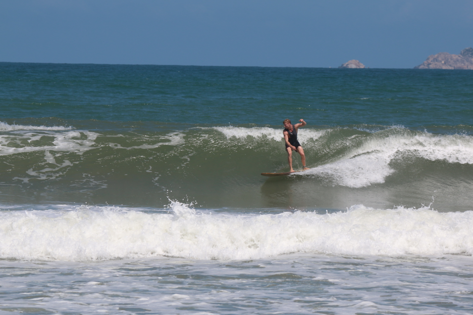 Dan surfing the long board on a nice right handed wave