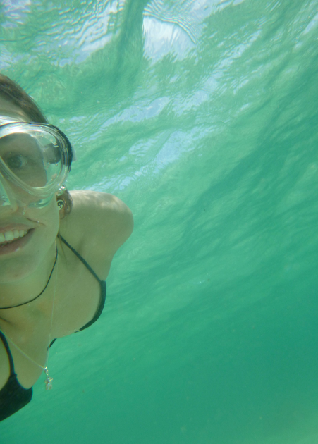 Tegan taking an underwater selfie with a snorkel mask on
