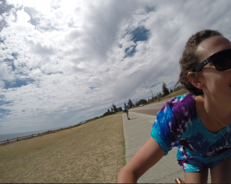 Action shot while on the long board skate board, cloudy skies but plenty of sunsihine