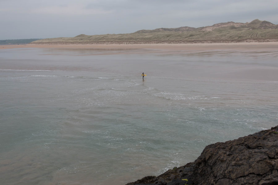 Dan making his way in from the surf
