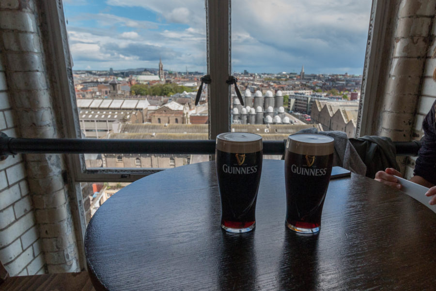 2 pints of guiness and the city of Dublin below
