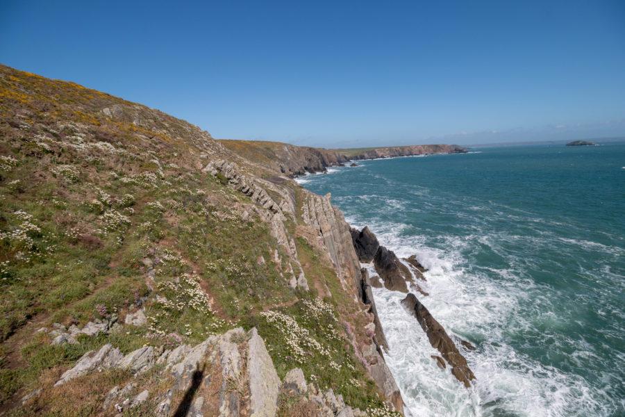 Ocean meets cliff tops.