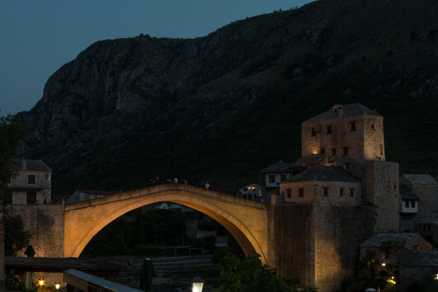 The stari most bridge lit up at night.