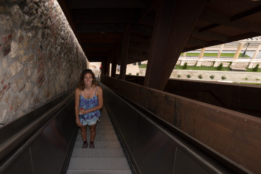 Tegan on an escalator going up