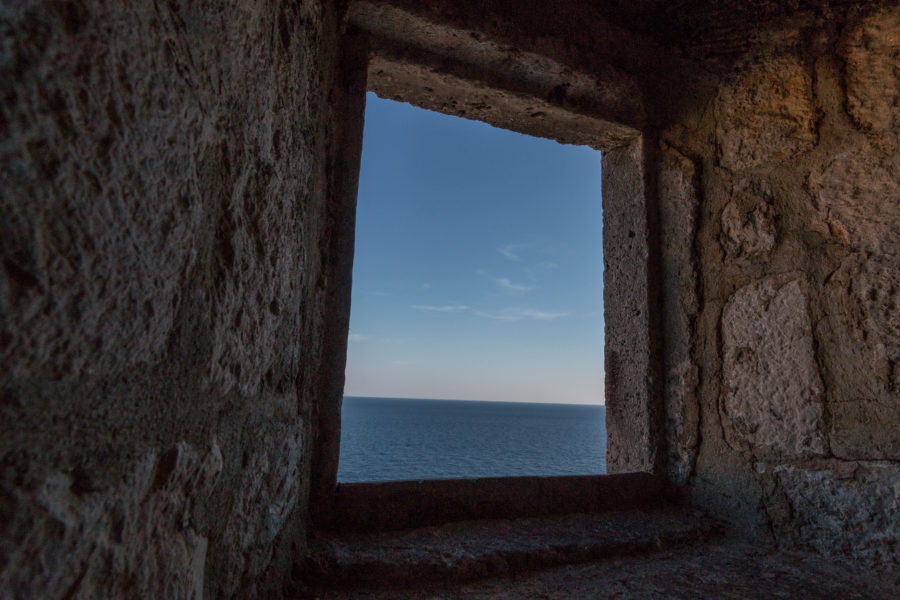 Looking out the hole in the wall to the sea