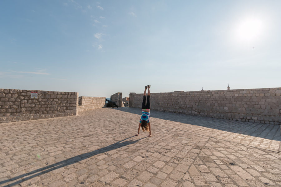 Tegan doing a handstands in the city walls