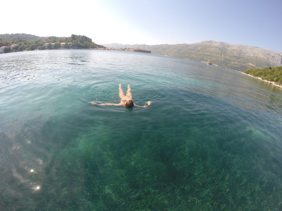 Tegan floating in the clear blue adriatic sea