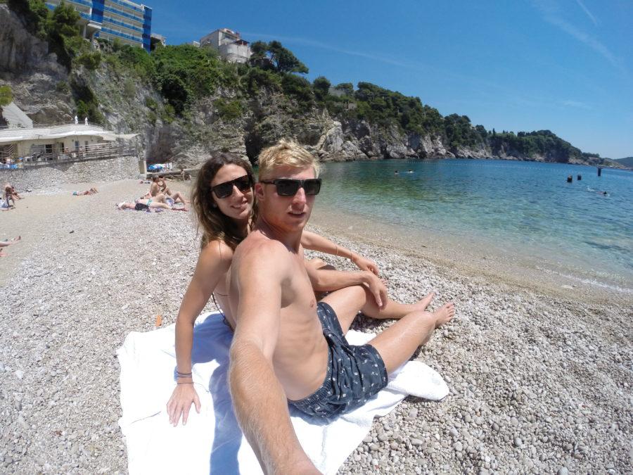 Selfie on the pebble beach, ocean in the background