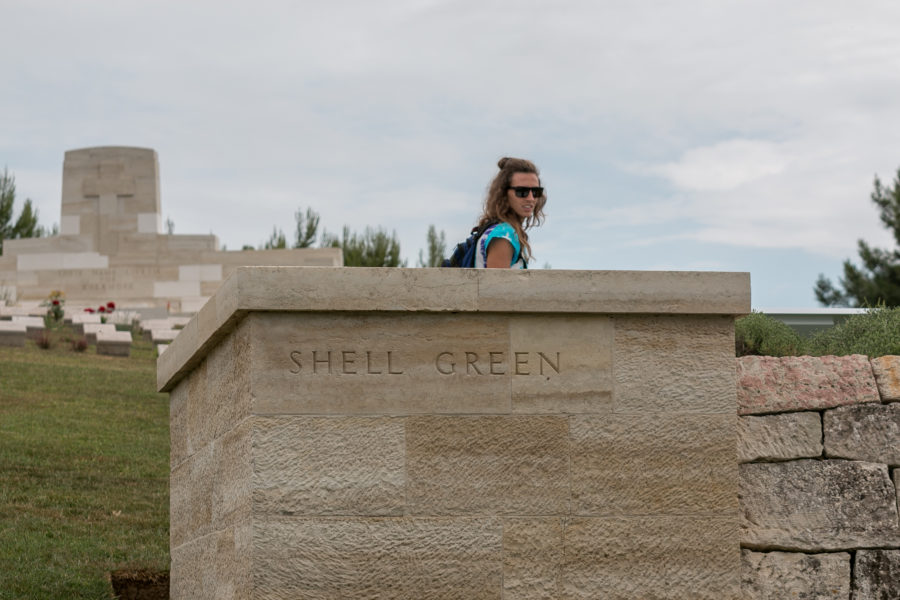 Tegan in the background, behind the wall saying Shell Green cemetery