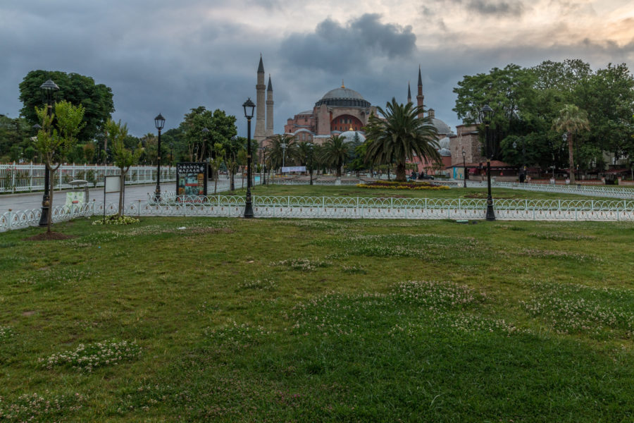 Green grass, street lights, grey morning clouds and the hagia sophia