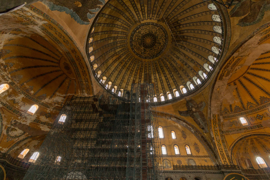 Scaffolding obstructing the view inside the Hagia Sophia, the massive ceiling with a huge circle and intricate designs on display
