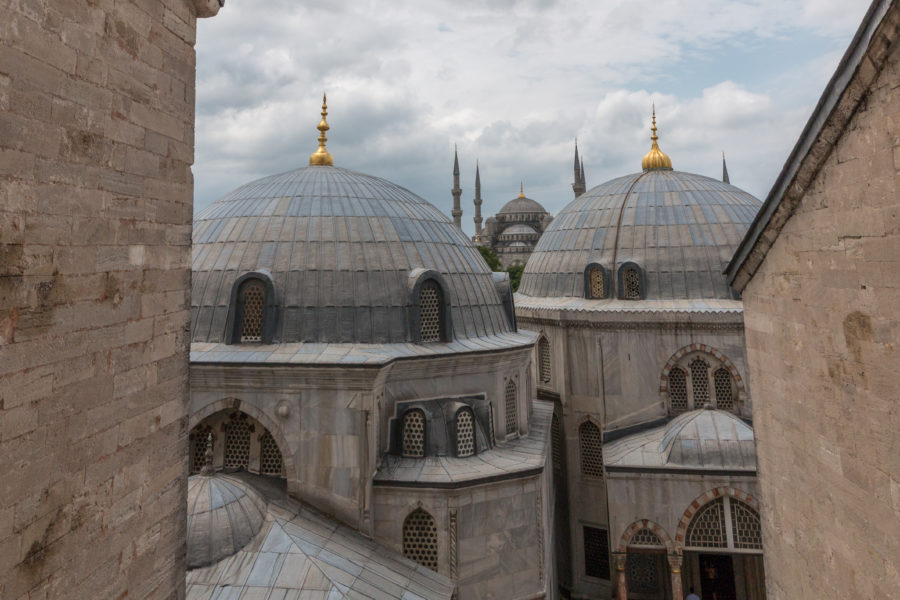 Looking out a window of the Hagia Sophia, the blue mosque in the distance