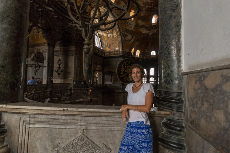 Tegan standing along the railing inside the Hagia Sophia