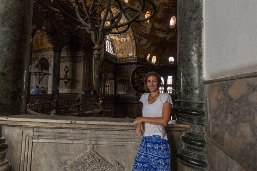 Tegan standing along the railing inside the Hagia Sophia