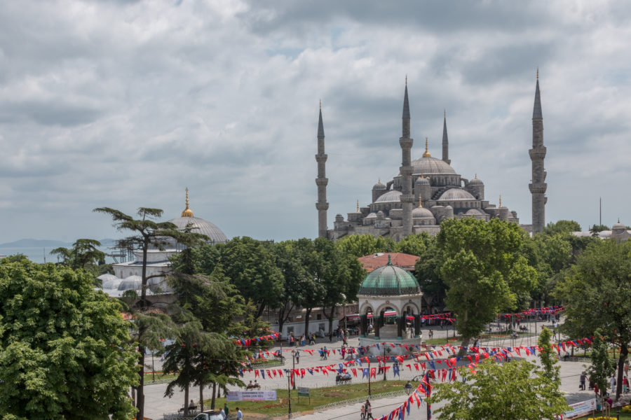 The blue mosque, cloudy skies behind, green park in front