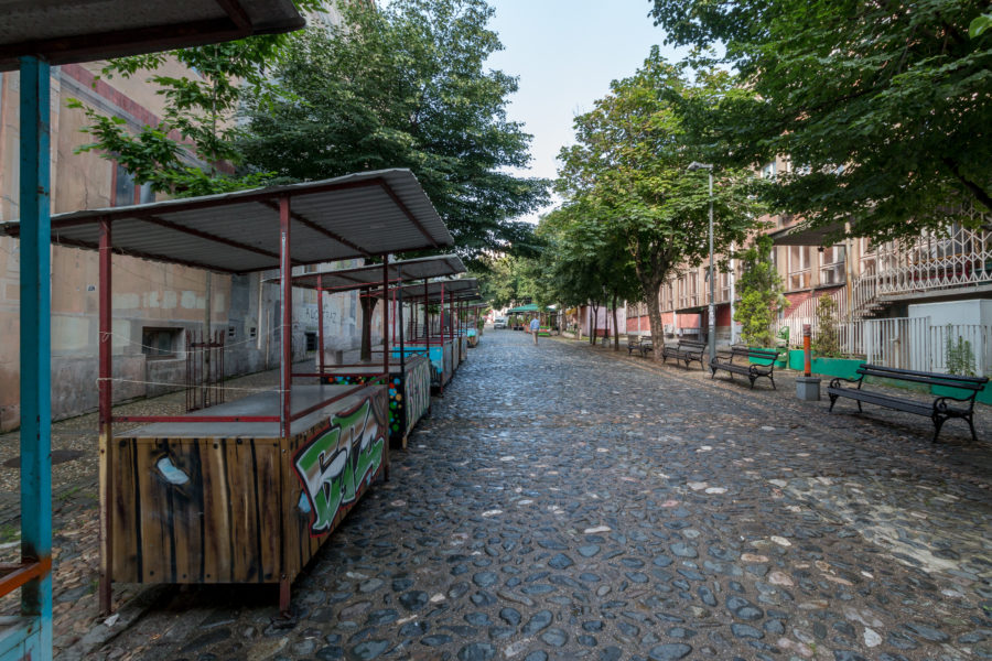 Stone walkway with market stalls on either side