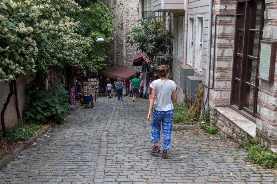 Tegan walking down a cobblestone path