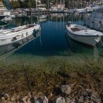 Boat docked in the ultra clear water. a very clear obvious drop from shallow to deep water