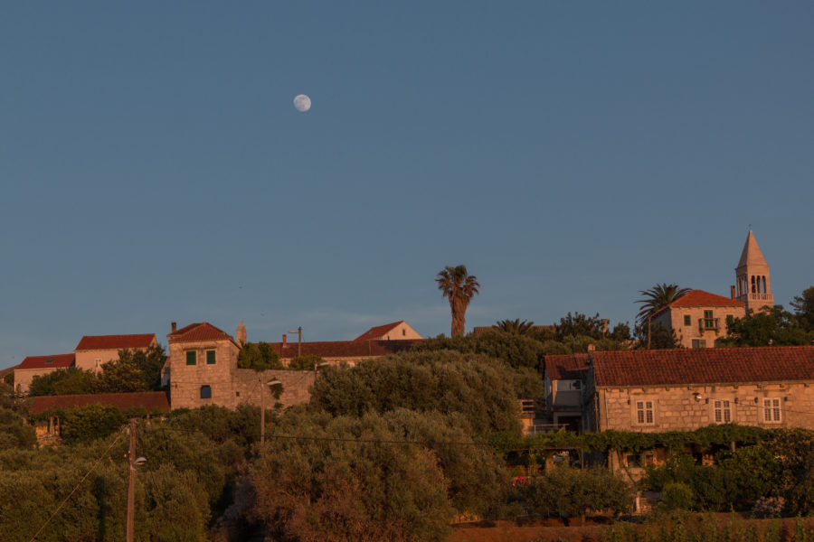Moon rise over stone houses
