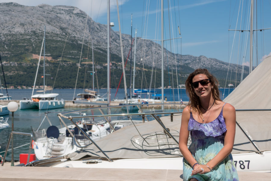 Tegan standing in front of yachts