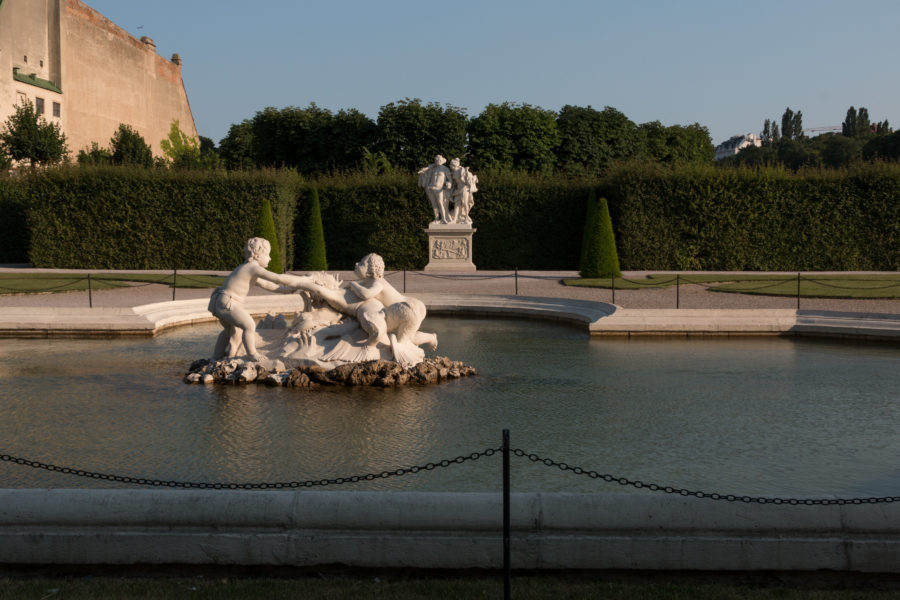 White statues in a shallow pond
