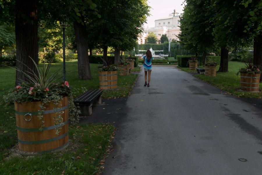 Tegan walking through the tree lined path