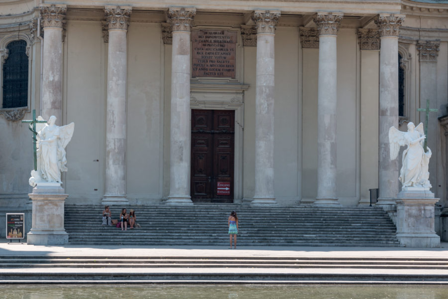 Tegan sitting on the steps of a HUGE palace