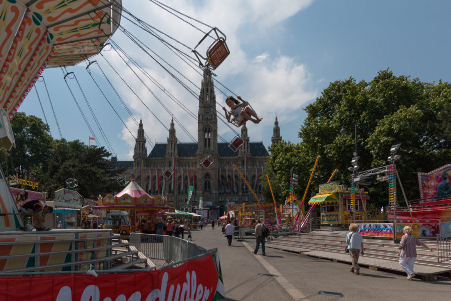 swing ride, swings with kids in them flying around in circles