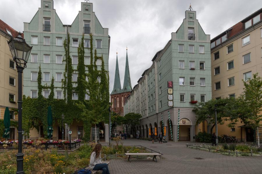 Greenish buildings grey skies