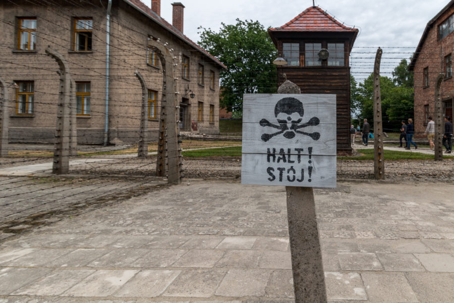 Skull and cross bones sign on the fence in Auschwitz