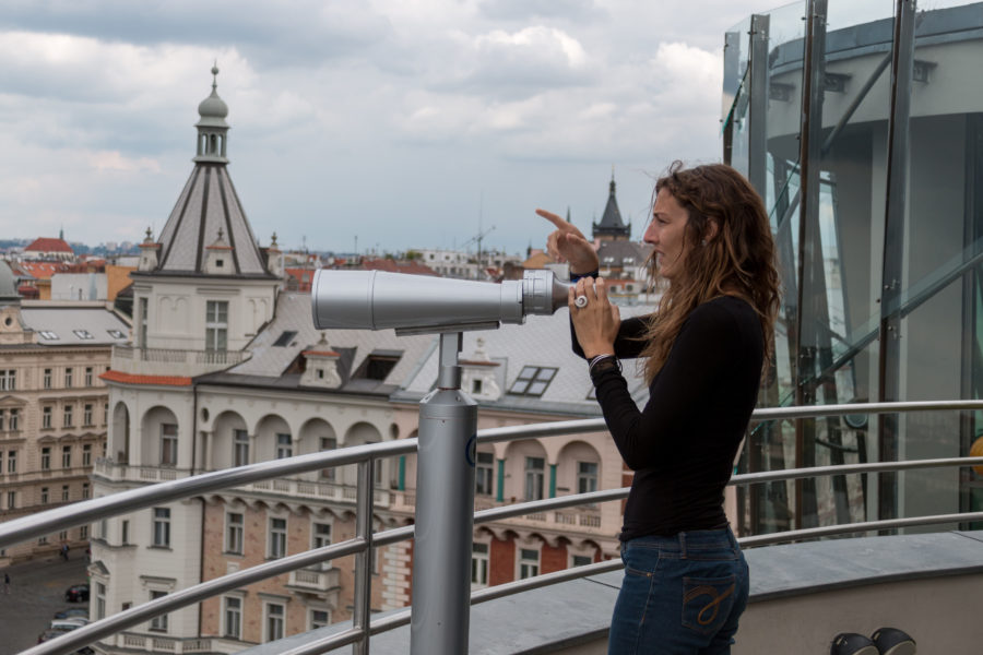 Tegan looking through giant binoculars