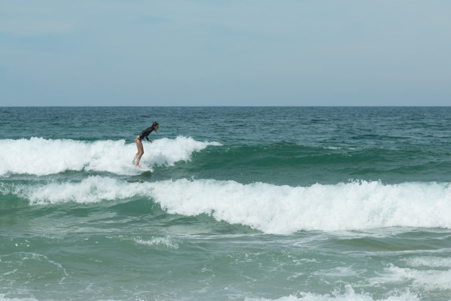 Tegan surfing