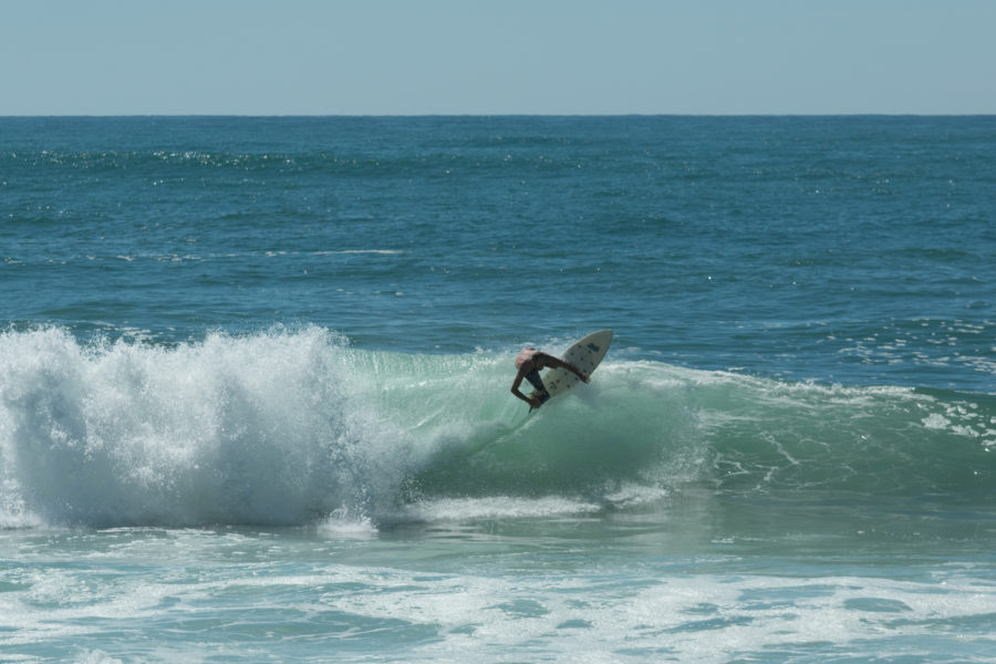 Daniel top turning on a wave