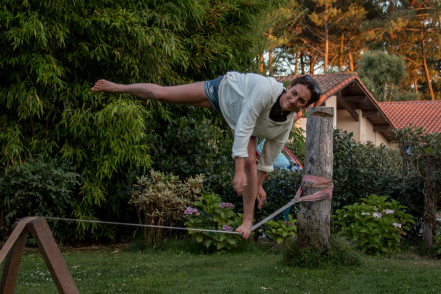 Half splits on the slackline