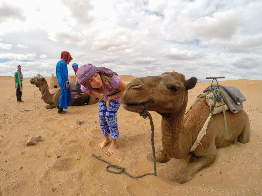 Tegan making a kiss face at the camel
