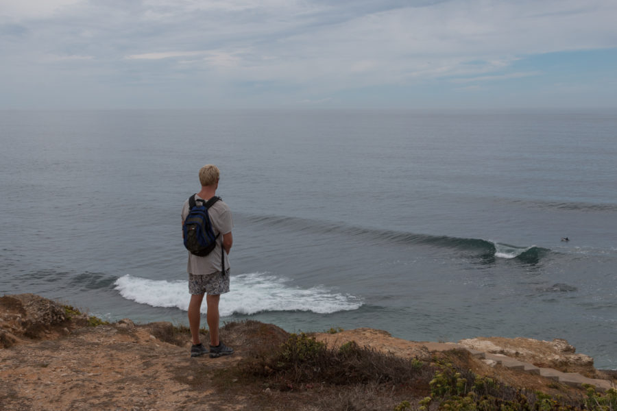 Daniel standing on the cliff checking the surf