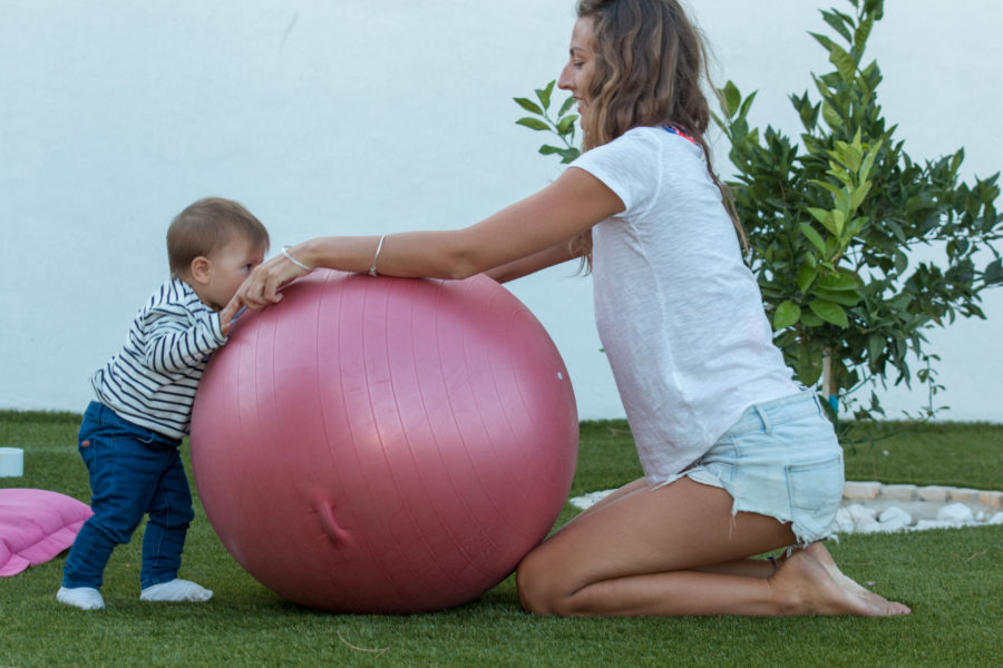 Tegan and Francisca playing with the gym ball