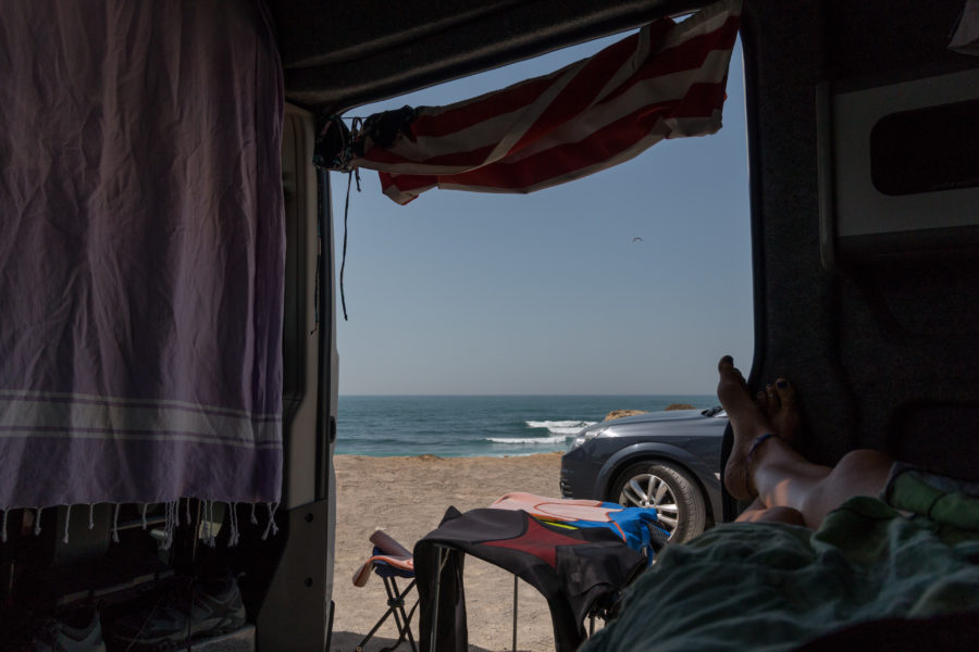 View looking out from the bed in the campervan out to the sea