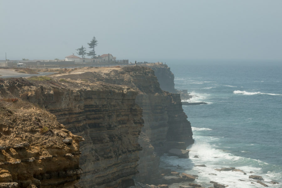 Peniche cliffs, ocean below and mist hugging the cliffs