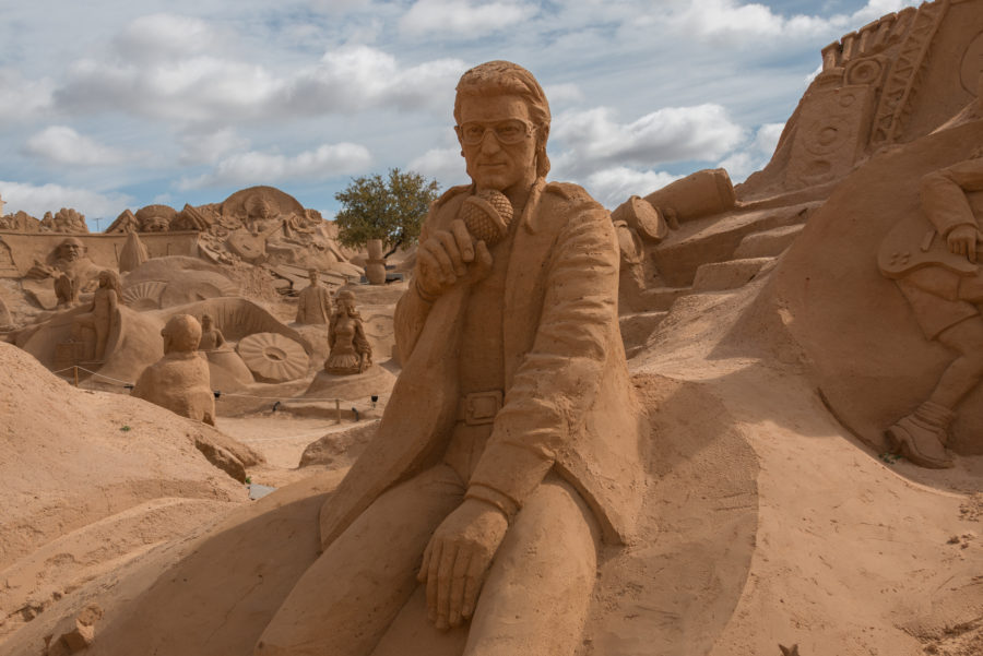 Elton John with a microphone sand sculptures