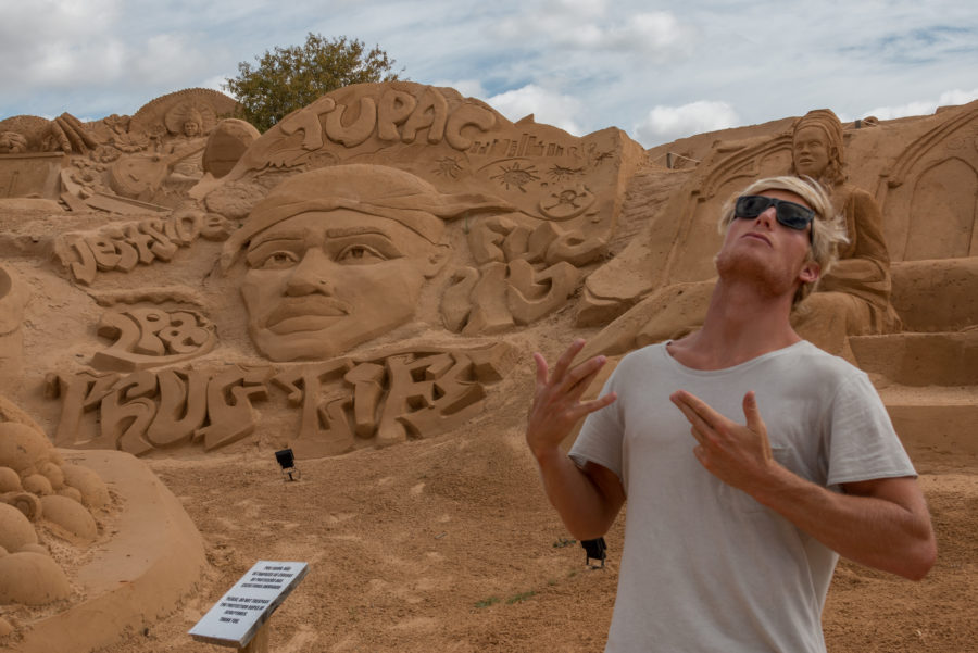 Dan pulling gangsta fingers in front of the tupac sand sculpture
