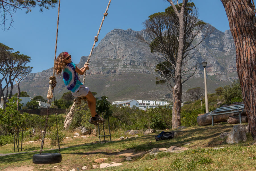 Tegan on a swing, table mountain range behind